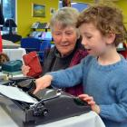 Jill Hulm, of Mosgiel, introduces her grandson Otis Jorgensen (6) to an old-fashioned manual...