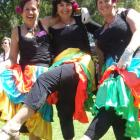 Jill Squire (left), Jude Robertson and Leanne Kingan dressed flamenco-style to serve an...