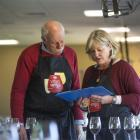 Jim Harre discusses the New World Wine Awards with fellow judge Kate Radburnd. Photo supplied.