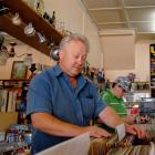 Jim Lloyd flicks through a lifetime's collection of second-hand records at his antiques store in...