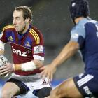 Jimmy Cowan (Highlanders) looks to get round Benson Stanley (Blues) in their Super 15 match at...