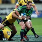 Jimmy Cowan of the Highlanders is tackled during the Super 15 match against the Hurricanes at...