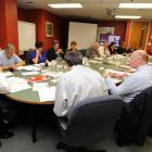 Joe Butterfield (left) chairs his first meeting of the Southern District Health Board. Photo by...