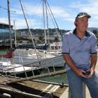 Joe Rongen on the jetty where his launch Manatee is moored in the Steamer Basin marina. Photo by...