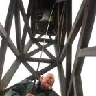 John Burton rings the bell at St Paul's Cathedral yesterday morning, heralding the arrival of the...