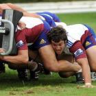 John Hardie puts his strength into pushing during Highlanders scrum training at Logan Park this...