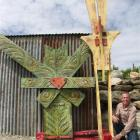 "John Herbison with his piece Caitanya  ""The Living Force"", in memory of the Christchurch..."