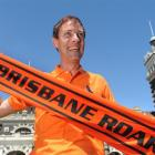 John McCormack, of Brisbane, makes his allegiance known outside the Dunedin Railway Station...