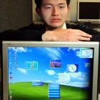 John McGlashan College pupil Cheng-Yueh Liu (16, left) displays the Windows sidebar application...