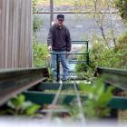 John Murray rides on the incline lift he built to keep a 30-year-old promise to wife Sandra. ...