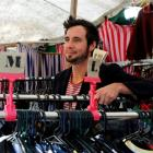 Jonas Karsten, of New Plymouth, in the Lucky Star clothing boutique, attached to his Bedford J4...