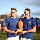 Josh (left) and Angus Macaulay celebrate with ''the Peanut'' after St Kevin's College's dramatic...