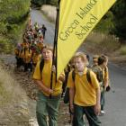 Joshua Sutherland (10, left) and Jimmy Lodge (10) led the group yesterday on a hike to the site...