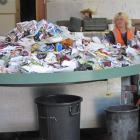 Julie Mitchell and Mick Goldie sort  recyclables on the new revolving sorting table at the...