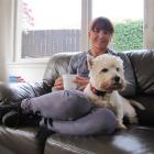 Julie Williamson relaxes at home with Rosie ahead of the World Ironman Championship in Hawaii...