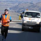 Jup Brown  jogs  up the Crown Range road above Arrowtown in early September  while his support...