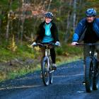 Kaci Hickox (L) and boyfriend Ted Wilbur go for a bike ride in Fort Kent, Maine. REUTERS/Ashley L...