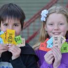 Kaikorai Primary School pupils (from left) Sean Kerr (9) and Victoria Dearden (11) with some of...