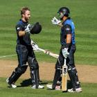 Kane Williamson (L) receives congratulations from Ross Taylor after reaching his century against...