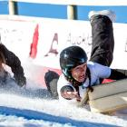 Karina Page, of Queenstown, shows how she hung on to win the women's section of the suitcase race...