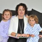 Kate Hesson, and daughters Holly (left) and Charlie spend a lot of time without husband and...