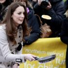 Kate Middleton flips a pancake on a visit to Belfast earlier this month.(AP Photo/Peter Morrison)