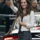 Kate Middleton waves to the crowds gathered outside the Goring Hotel in London on the eve of her...