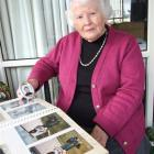 Kathleen Cleveland in her Alexandra home yesterday, looking over photo albums belonging to her...