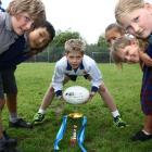 Kavanagh College's Jack Buchan (12, centre) organised a rugby tournament for former schoolmates...