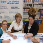 Keep it out of sight: Queen's High School Health Committee members (from left) Rebecca Webb (17),...