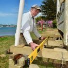 Keith Lewis works on the Lewis cottage at Deborah Bay. Photos by Gerard O'Brien.