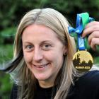 Kelly Brazier holds her sevens World Cup medal at her Dunedin home. Photo by Craig Baxter.