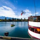 Kelly McGarry performing a backflip on his bike from the roof of the TSS Earnslaw.