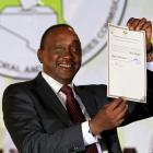 Kenya's President-elect Uhuru Kenyatta displays the certificate from Independent Electoral and...