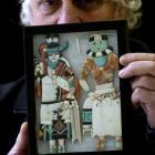 Kevin Hayward displays a pair of Zuni inlaid figurines, part of an online auction of North...