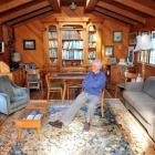 Kevin Hayward reflects on his career, seated in a wood-lined room he helped build above his...