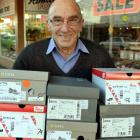 Kevin Thomas moves stock to the new Thomas Shoes store in South Dunedin before  retiring at the...
