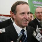 National Party leader John Key talks to the media