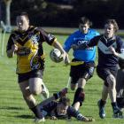 Kia Toa player Robert Dean runs with the ball during his side's Otago competition match against...