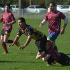 Kia Toa Tigers halfback Joseph Wrathal gets the ball away in the tackle of East Coast Eagles...