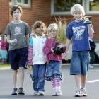 East Taieri School pupils (from left) Guy Guilford (11), Erica Siboharawai (5) and James Baker ...