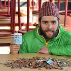 King's High School chemistry teacher Anthony Rodger with the loose change he has collected so far...