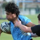 King's High School No 8 Junior Faa'vae attempts to break the tackle of Waitaki Boys' High School...
