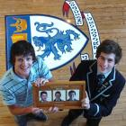 Kings High School 2006 dux Bonar Robertson (left) and his brother Bede (2008 dux) hold a plaque...