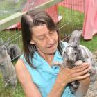 Kintella Rabbit Stud owner Pamela Platten (60) with Little Andy on the Dunedin stud quarantined...