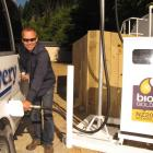 Kiwi Discovery and Queenstown Rafting general manager Tim Barke fills up at New Zealand's first...