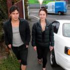 Kotahi Parata and Julia Blair walk past a car legally parked on a designated footpath in Kaikorai...