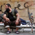 Kurdish Free Syrian Army fighters rest on a roadside in Ashrafieh, Aleppo. REUTERS/Muzaffar Salman