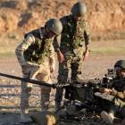 Kurdish Peshmerga fighters undergo training by British soldiers at a shooting range in Arbil, in...