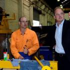 Labour Party leader David Shearer (right) talks to James Hardisty, of Wilson Electrical, during a...